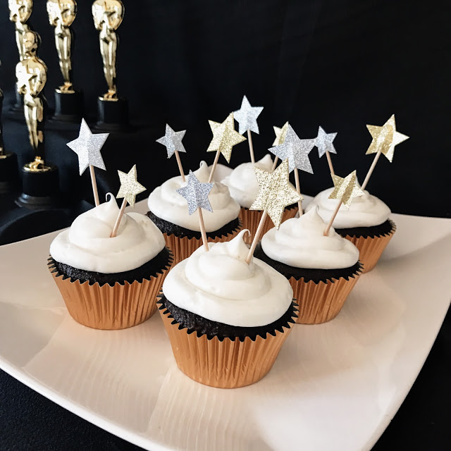 cupcakes with metallic gold and silver star toppers for an oscar party