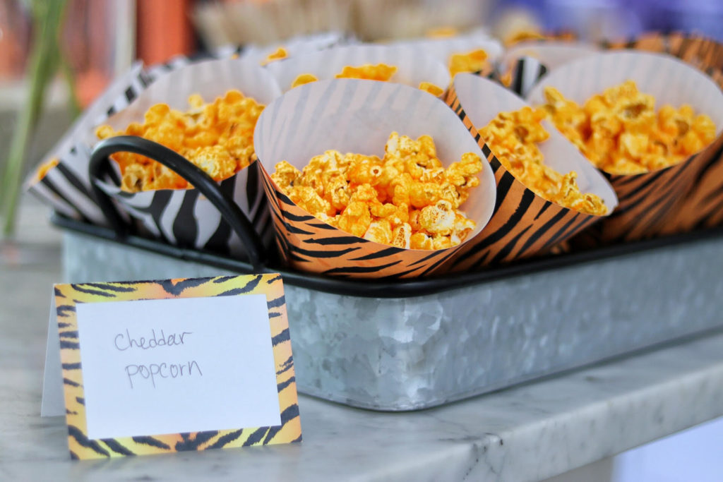 cheddar popcorn for a tiger party food idea, served in free printable party cones